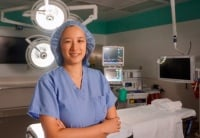 Dr. Sue Jiang posing in operating room