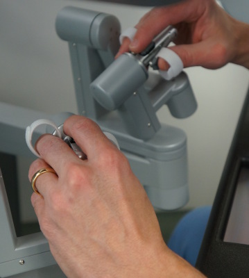 Close-up of surgeon's hands controlling Da Vinci Surgical System